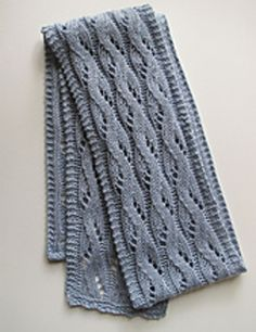This scarf showcases a wavy lace pattern framed by a crisp garter stitch edge on all sides.