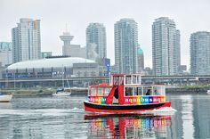 A vibrant aquabus on our Olympic Village photowalk Vancouver Neighborhoods, Olympic Village, Olympics, New York Skyline, The Neighbourhood, Bucket, Vibrant, Travel, Beauty