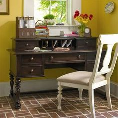 """Turned writing desk with a power outlet and drop-front center compartment.Product: DeskConstruction Material: WoodColor: TobaccoFeatures:Part of the Paula Deen Home Collection Distressed finish accentuates country designTwo deep left and right file drawers with full extension metal guidesPower outletDimensions: 37"""" H x 58"""" W x 30"""" DNote: Chair not included"""