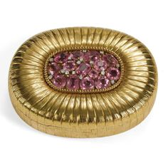 1930s Verdura Gold and Gem-set Compact. Yellow gold compact, the lid pavé set with a mixture of pink stones including topaz, sapphire, morganite, and kunzite.
