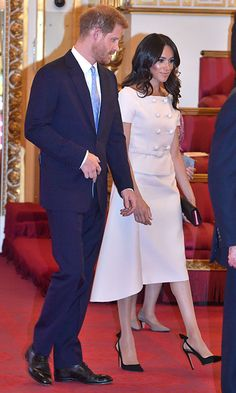 Meghan, the Duchess of Sussex joined Prince Harry at the Queen's Young Leaders Awards Ceremony at Buckingham Palace on June 26. For the occasion, the new royal wore a double-buttoned skirt suit by Prada.