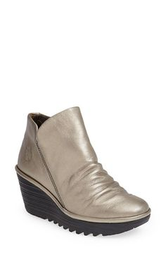 Fly London 'Yip' Wedge Bootie (Women) at Nordstrom.com. A heavily lugged wedge sole adds bold, trend-right appeal to a soft, slip-on bootie that looks like a million bucks but feels a little bit like your favorite gym shoe.