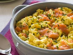 For an elegant breakfast in a flash, Rachael folds smoked salmon into her 6-minute scrambled eggs. Crisp, fresh chives add bright color and a subtle onion flavor.