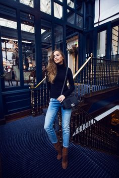 Draw attention to your favourite jeans by wearing them with a simple plain turtleneck like this black one worn by Kenza Zouiten. To recreate this cute and casual look, wear faded denim with tan...