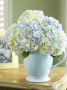 Create a soft springtime centerpiece using a pastel colored pitcher to place a bouquet of flowers.