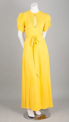 A fabulous example of Ossie Clark at his best! Original maxi gown in primrose yellow silk crepe with puff sleeves. The dress ties at the waist on the back, like a reverse wrap dress. Due to the 'wrap' style of the dress, your legs are exposed when y Tie Dress, Wrap Dress, Ossie Clark, Maxi Gowns, Dresses For Work, Summer Dresses, Silk Crepe, Vintage Fashion, Lana Del Rey