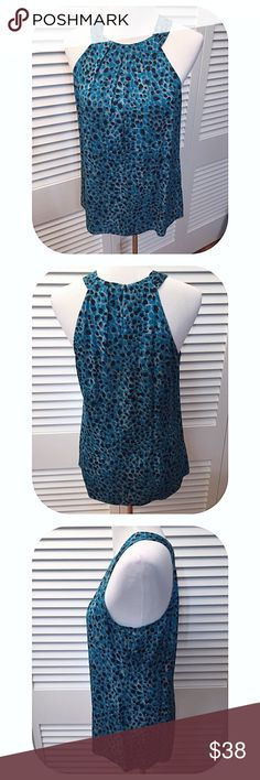 Ann Taylor Silk Cheetah Print Racerback Blouse Ann Taylor Silk Cheetah Print Racerback Blouse. Folded pleats at the neckline. Covered button keyhole back close. Blue and black cheetah print. 94% Silk. 6% spandex for a little stretch. In EUC. Ann Taylor Tops Blouses