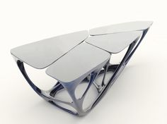 The mesa table by Zaha Hadid represent waterlilies as the tables surface and the supports as waterlily stems.