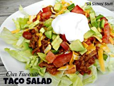 Our family's favorite Taco Salad- everyone builds their own just the way they like it. The meat is what makes this dish- it has some delicious ingredients! #salad #recipe