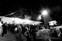 フランス・カンヌ(Cannes)で開催中の第67回カンヌ国際映画祭(Cannes Films Festival)の試写会場に集まる人々(2014年5月17日撮影)。(c)AFP/VALERY HACHE ▼19May2014AFP|不明マレーシア機が題材の映画2本、カンヌで試写会 http://www.afpbb.com/articles/-/3015301 #Cannes_Films_Festival