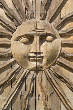 Sun-Face carved on a wooden door in Mexico
