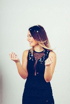 Attractive female model smiling in celebration mood  by Branislava Živić for Stocksy United