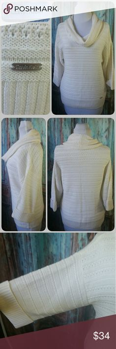 CALVIN KLEIN cowl neck sweater Winter white pointelle cowl neck sweater with loose 3/4 length sleeves. Great condition. No size tag. I'm guessing a medium or large. Will add measurements later Calvin Klein Sweaters Cowl & Turtlenecks
