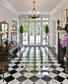 I grew up in a house on Lenox Place with a front hall like this--black and white checkerboard floor, the walls lined with antiques. Traditional Entry by Kim E Courtney Interiors & Design Inc Floor Design, House Design, Tile Design, Checkerboard Floor, Checkered Floors, Black And White Marble, Black And White Flooring, Marble Floor, Carrara Marble