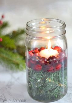 Looking for a creative way to use those empty mason jars? This easy tutorial is the perfect craft to can make before your holiday party. All you'll need for this DIY Christmas Candle Holder are evergreen twigs, cranberries, and a votive candle and you'll have your very own festive homemade decoration.