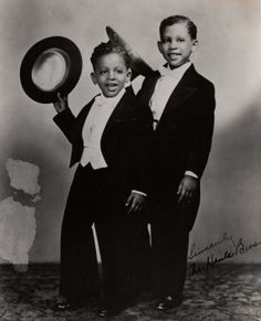 """Gregory Hines (left) with his brother Maurice (right) - they danced as """"The Hines Kids"""" and appeared as 'Hines, Hines and Dad' when their dad joined them in 1961."""