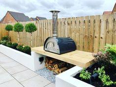 Integrated garden cook station with log store Log Store, Family Garden, Contemporary Garden, Outdoor Furniture Sets, Outdoor Decor, Garden Projects, Garden Design, Gardens, Cook