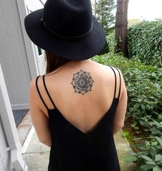 Small and gorgeous mandala tattoo on the back