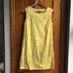 """Lily MADE IN USA Floral Dress Size: S LIKE NEW ☀️Cute Spring/Summer☀️ Dress Size: S // MADE IN USA // High quality! // Color: Yellow (also comes in black) // Material: 65% Cotton + 35% Polyester Lining: 100% Cotton // Side zipper // Bust(underarm to underarm when laid flat):17"""" Waist:17.5"""" // Length:29.5"""" // 15% off on bundles // Cutest dress you can wear at work or on the weekends! // I ship same-day from pet/smoke-free home. Buy with confidence. I am a top seller with over 400 5-star…"""