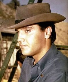 "August 04, 1960  Elvis was fitted with contact lenses to change his blue eyes to brown for his role as a half-breed for his role in ""Flaming Star: . In the end he kept his own natural look."