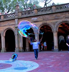 When we were walking through New York's Central Park a couple weeks ago, we came upon a man making giant bubbles. Ella was mesmerized. She thought it was the best thing she had ever seen.