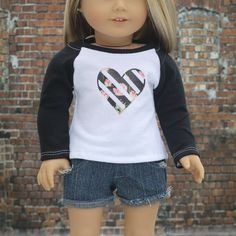 American made in Columbus, Ohio. Your favorite baseball tee style! -Knit Fabrics -Heat Transferred Vinyl Graphic -Black Long Sleeves -Black Neckband -White Topstitching -Fitted (close to body fit) -Regular Length -Velcro Closure in back for easy on and off -C4C clothing tag stitched inside This listing is for ONE TOP. All other items in the photos are props. Seams are finished and serged where appropriate. I use a mixture of new and like new upcycled materials in my projects to help the…