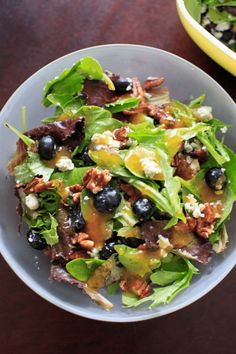 """An """"Italian Blue"""" Salad - mixed greens served with blue cheese, honey roasted pecans, fresh blueberries and a homemade apricot vinaigrette dressing. If you like fruit in your salad, you will love this creative spin on a fresh summer salad. Vegetarian, gluten-free. Best Appetizer Recipes, Best Vegetarian Recipes, Best Dinner Recipes, Best Appetizers, Healthy Salad Recipes, Lunch Recipes, Meatless Recipes, Cookbook Recipes, Fruit Recipes"""