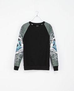 Es un azulejo y negro el suéter