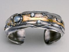 The Laura Cuff by Wendy Thurlow: Formed silver, 18k gold, 22k gold, aquamarine