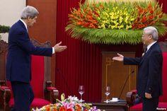 FILE - Vietnam's Communist Party General Secretary Nguyen Phu Trong greets U.S. Secretary of State John Kerry (L) in Hanoi, Dec. 16, 2013.