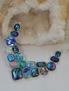Simply amazing three-dimensional color in every piece in this artisan Dichroic Glass collection! This handmade Dichroic Glass necklace tells a story in each original glass bead, set in 925-hallmarked