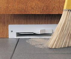 Central vacuum eco-vent floor vent...best thing ever, worth the cost of the central vac system. Brooms away the beach sand.
