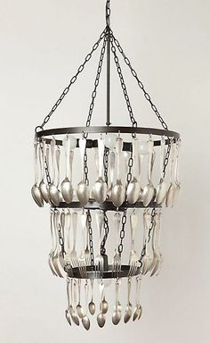 "Add some baubles and a pendant can easily become a chandelier. (Though, I have left ""chandeliers made from upcycled vintage treasures for another day.)  This Eat Drink Be Merry Chandelier by Jose Esteves for Anthropologie  turns vintage spoons and forks into a $4,800 work of art."
