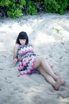 on the beach in ko olina wearing a pretty popavina dress from audrey grace boutique.