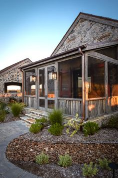 Texas hill country home designer homes exterior for Back portico ranch