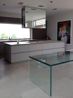 Contemporary Italian kitchens for contemporary homes. Featuring the Santambrogiomilano glass dining table and Effeti kitchen