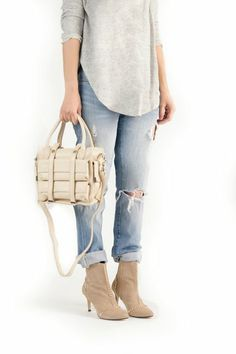 NYC Mini Satchel.....cute booties, perfectly ripped jeans....cute outfit, although I would add a long chain necklace.