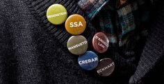 """Regenstein reference librarian Julie Piacentine designed six library pins. The response has been unexpectedly enthusiastic.  Piacentine designed one limited-edition pin for each of the University's branch libraries, distributing them at orientation events. The librarians usually put out a mix of pins in a basket. """"Students will sift through to find their favorite campus library,"""" says Piacentine. """"Or they'll take the time to collect all six, even if they're not familiar with  . . ."""