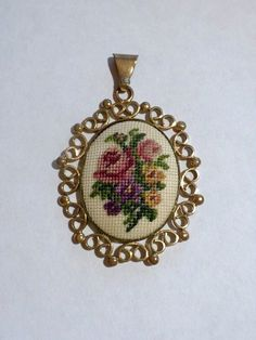 vintage embroidered cameo pendant, gold color by brixiana on Etsy https://www.etsy.com/listing/173089466/vintage-embroidered-cameo-pendant-gold