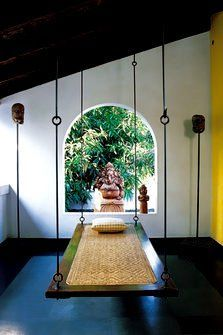Old time Kerala - wooden swing with woven cane centre. Malabar House hotel, Fort Kochi
