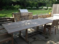 Here is a Gloster teak Bristol Extending table being delivered to a happy new Nantucket client