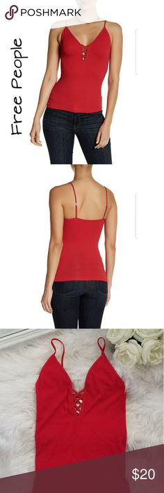 Free People Cami New with tags,  adjustable straps, very stretchy. Fits a Medium/Large.  Please see all pics before purchasing.    92%Nylon  8%Spandex Free People Tops