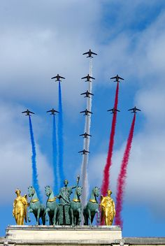 French Bastille Salute  The French Patrouille de France fly over Paris in a Croix de Lorraine formation, smoke on! Photo:  Stephen Wolf, Antony, France