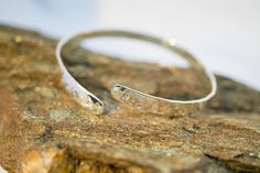 Hammered silver cuff bracelet with two little sparkling pink