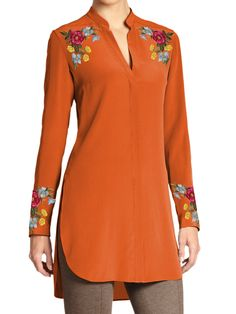 Simply elegant! This top kurti tunic has an elegant touch. Delicate yet colorful floral pattern is embroidered on the shoulder as well as along the full sleeve cuff. This tunic is available in a variety of colors. Buy one in every color and mix and match it with trousers and accessories. - Customized according to your size - Available in Linen, Silk and Silk Chiffon (full lining with Chiffon) - Machine Embroidery - Full sleeves - V Neck
