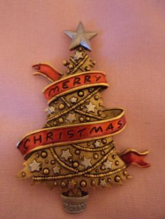 This listing is for a Vintage Signed JJ Red Ribbon Christmas Tree. In very good condition. Approx 2 1/2 inches high. I try to describe these items as