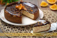 Cheesecake arancia e cioccolato cotta al forno. E' un dolce fresco e goloso preparato con una base di biscotti e con un ripieno di formaggi. Una ricetta facile e veloce del dolce americano amato da tutti. Perfetto per occasioni speciali.