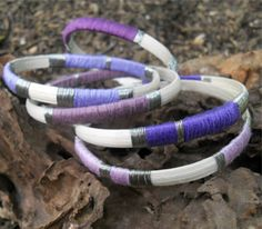 Purple and silver bangles. Great compliment to a fall wardrobe.
