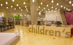 Environmental graphics by Bruce Mau Design, Seattle Public Library by Rem Koolhaas #signage childrens desk