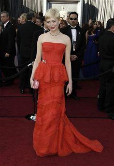 Best Dress    Michelle Williams in red-orange Louis Vuitton gown with peplum detailing.